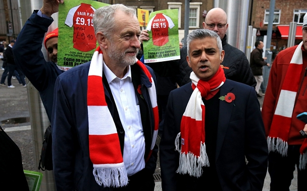 """Labour leader Jeremy Corbyn with London mayoral candidate Sadiq Khan MP and fans protesting against football ticket prices before the Barclays Premier League match at the Emirates Stadium, London. PRESS ASSOCIATION Photo. Picture date: Sunday November 8, 2015. See PA story SOCCER Arsenal. Photo credit should read: Nigel French/PA Wire. EDITORIAL USE ONLY No use with unauthorised audio, video, data, fixture lists, club/league logos or """"live"""" services. Online in-match use limited to 75 images, no video emulation. No use in betting, games or single club/league/player publications."""